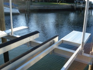 An aluminum stern platform and set of bunks installed on a boat lift