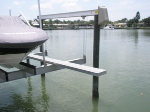 An aluminum walkboard installed on a boat lift as an accessory